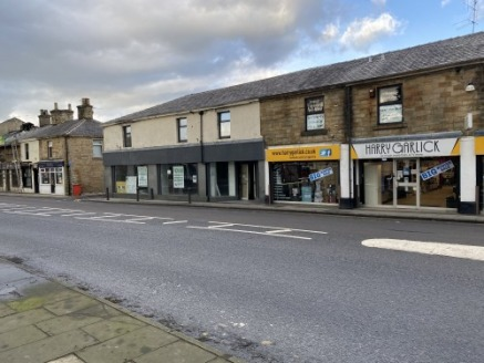 A substantial ground floor retail premises in a prominent location in the popular town of Padiham positioned between Clitheroe and Burnley.\n\nThe property is in a main road location next to Harry Garlicks and close to Padiham Paints, Tesco's Superst...