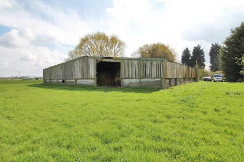 A rare opportunity to purchase a smallholding with detached farmhouse, range of general purpose farm buildings (two with residential consents) and good sized yards, all in a rural location with access to main line stations. In all approximately 22.02...