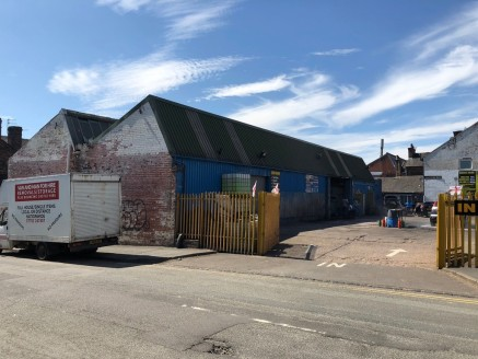 A detached workshop/trade counter unit of brick elevation supporting a steel truss pitched roof surface extending to 4,176 sq.ft. (GIA) together with a well proportioned yard with extensive roadside frontage.