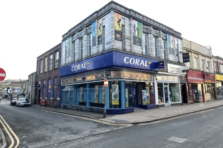 The property briefly comprises a prominent corner retail investment block comprising two self-contained retail units at ground floor level together with separately accessed self-contained first-floor dance studio and premises.  Planning  The property...