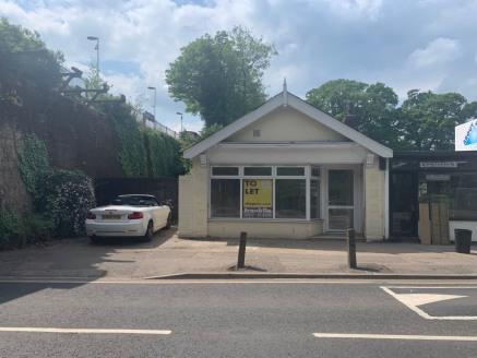Premises and yard to let opposite Esher Train Station