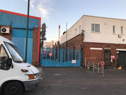 Previously used as a bakery arranged as three interconnecting warehouses with first floor offices. Various access points and loading bays to the front and side of the building along with parking.