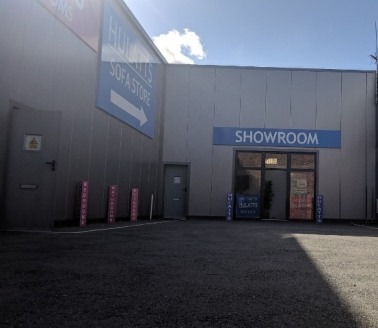The unit which is currently used as a furniture showroom comprises an original steel frame part brick, block and steel smooth profile clad unit benefitting from 10 feet minimum eaves, powder coat recessed glazed shop front behind roller shutter door,...