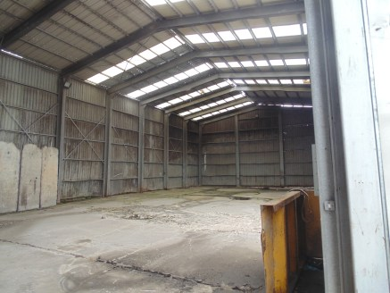 Three units totalling 7,820 sq ft. Large concrete yard of 0.52 acres. Eaves heights from 4m to 7m.