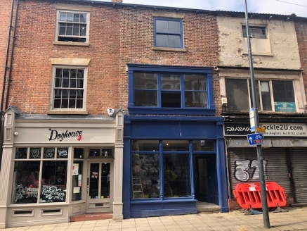 The property comprises a three storey commercial building located in a terrace block fronting Lower Kirkgate. Internally the accommodation is arranged to provide a ground floor sales area with additional sales accommodation on the first floor. The se...