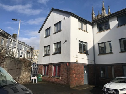 The property was constructed in the late 1980s as part of a development known as Farrer Court which comprises 3 attached office buildings. To the rear and serving all 3 buildings is a private car park within which 2 spaces are allocated.  The buildin...