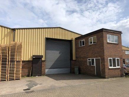 The property forms part of a pair of semi-detached industrial units which are of portal frame construction with facing brick lower elevations and a profile sheet upper aspect surmounted by a pitched sheet roof incorporating translucent roof lights....