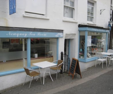Leasehold Tea Rooms & Cafe Located In Newquay\nProminent Town Centre Location\nRef 2364\n\nLocation\nThis delightful Tea Rooms & Cafe is located within a busy parade of shops just off one of the main thoroughfare roads in Newquay town centre. Newquay...
