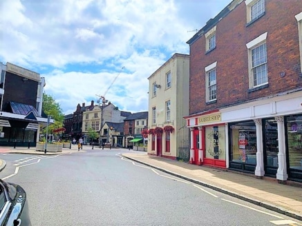 The property comprises an extremely prominent retail unit, fronting the busy High Street. The unit consists of one open plan sales area which leads in to a small kitchen and WC to the rear.