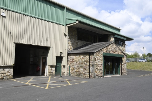 The premises are of a steel portal framed construction, with profile metal cladding and brickwork to approximately 2 metres. The entrance and three storey offices have been clad in stone, access to the warehouse is via 4 dock level loading doors (4m...