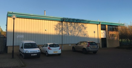 The property is of steel portal frame and blockwork construction with profile sheet roof. There is a shared secure, gated rear yard and parking to the front of the premises. The unit contains ground and mezzanine level office accommodation. The offic...