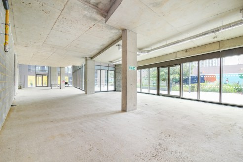 The unit is currently in shell and core, however a basic fit out completed by January 2020. The property benefits from a 26 x 4 meter window frontage emitting lots of natural light. There is large outside patio area overlooking the garden at the cent...