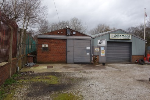 The property comprises of a former vehicle servicing and repair unit, which is mostly of steel portal frame construction, with two main bays and concrete floors throughout.  The roof is asbestos cement and has single skin filon roof lights, with acce...