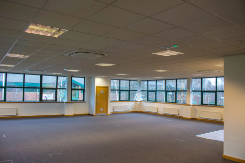 Full raised access floors    Diffused lighting within suspended ceilings   Air conditioning system    Gas central heating    Double glazing    Secure car park with bollards   Security doors to offices   Data cabled   Location   This building forms pa...