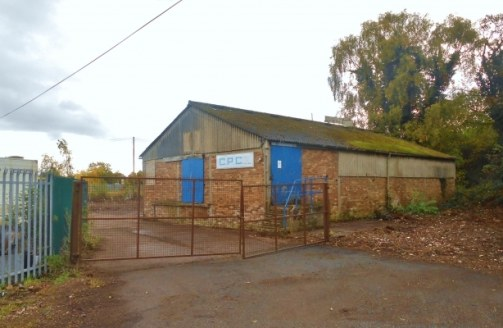 The property comprises a detached industrial unit on a site of approximately 1 acre including a good sized yard, which wraps around the building.<br><br>The building is currently arranged to provide a clear span workshop area with two rear storerooms...