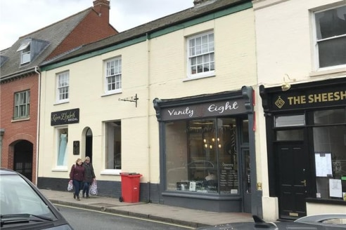Prominent town centre retail premises. The property is arranged over ground floor providing open plan retail on split levels to the front elevation. To the rear are two further rooms which could be used for treatments or as ancillary office. The spac...