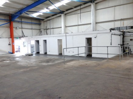 "Recently refurbished detached workshop/warehouse unit incorporating integral offices, staff and WC facilities. Vehicular access is via 2 no. roller shutter doors. The unit has a clear eaves height of 5m(16'5""). Externally the unit has a good sized fo..."