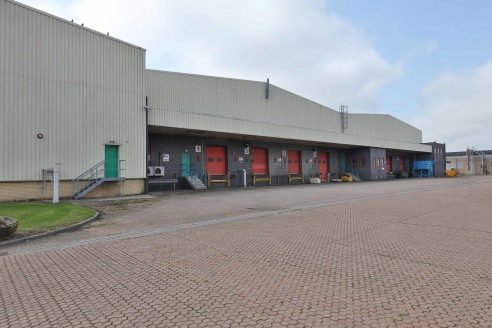 High quality racked warehousing. Flexible lease terms. 13 dock level loading doors. 7.8m minimum eaves height. Fork lift trucks available on site. Warehouse heating and lighting.