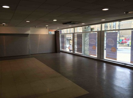 The property comprises the ground floor of a larger multi storey office building and provides predominantly open plan retail showroom accommodation benefiting from a substantial glazed frontage including internal security shutters to High Street.  Th...