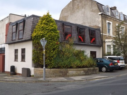 Established respected Tenant.\n* Purpose built two storey offices in 1987.\n* Current Rent £12,000 per annum.\n* Prime Location.\n\nLOCATION\n\nThe property is situated on the corner of Bank Parade and Parker Street in a prominent location bein...