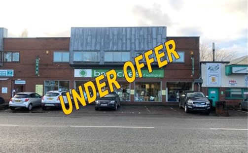 The property comprises a two storey retail unit with off-street parking across the frontage and additional parking to the rear.   Internally the ground floor provides an open plan retail area, store room, office and goods lift.   To the first floor t...