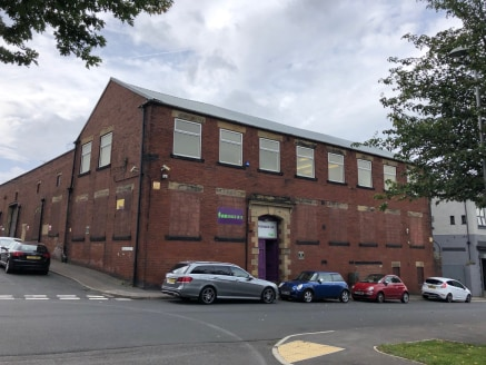 The property is a traditional style industrial/ manufacturing unit with a north light roof, brick walls and a concrete floor. Loading is via a steel roller shutter door, externally the property benefits from a small shared yard area.   Office content...