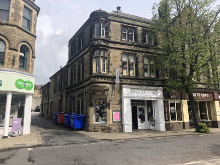 The premises comprise a corner unit in an attractive stone fronted terrace and include a well appointed ground floor sales shop. The unit enjoys the benefit of an attractive double entrance with display glazing, as well as window frontage to the spla...