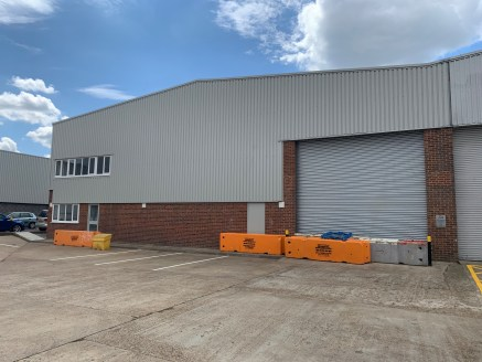 The unit is of steel portal frame construction with brick elevation and steel profile cladding. The unit benefits from a roller shutter door and loading area with first floor offices and yard / car parking to the front.  Photo are of a unit on the es...