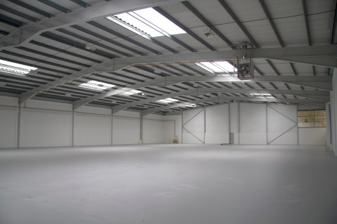 Steel portal frame unit. 6m eaves height. Blockwork walls to approximately 2.5m and clad above. Pitched roof incorporating approximately 10% roof lights. No. 2 up and over loading doors (4m wide by 5m high). Warehouse lighting. Two storey offices.