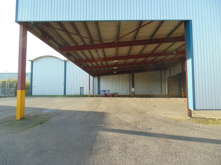 Extensive refurbished warehouse/industrial building. Eaves height up to 8.4m. 5 level access loading doors. Dock level loading. Two storey offices. Secure service yard.
