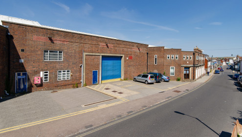 * Former vehicle workshop and stores previously occupied by Sussex Police  * Externally there are yards, surface car parking and a fuel filling pump  * Existing use or redevelopment potential  * Unique opportunity to acquire a development opportunity...