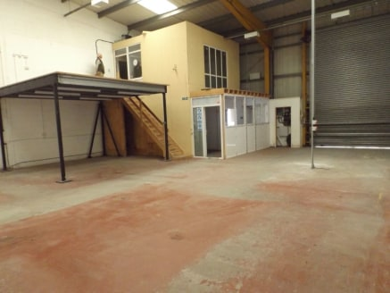First Floor office with Mezzanine storage facility.\n* Generally open plan warehouse / manufacturing facility.\n* Three phase electricity.\n* Close proximity to junction 8/9 of the M65 motorway....