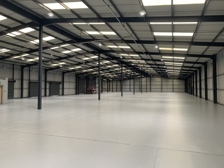 Detached warehouse / distribution unit. Dedicated parking with 90 spaces. Lighting throughout. Access via a combination of drive in and dock level loading. Eaves height from 5m - 9.2m. Fully fenced and gated site.