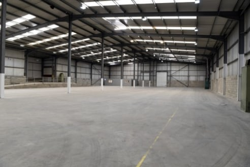 A superb high bay warehouse facility located on a popular and established Business Park in the town of Burnley.\n\nThe property is of steel portal frame construction with insulated profile cladding and offers mainly open plan warehouse accommodation....