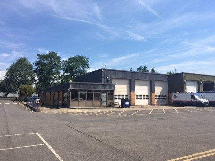 The property includes a large yard area which is shared in part with the adjacent occupier. Approximately 2,264.49 sq. m. (0.559 acres) of yard is available excluding parking.  In the main the property comprises brick built offices with flat roof wit...