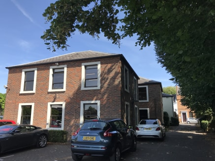 The property comprises a two-storey period office building fronting the High Street with purpose-built two-storey office extensions. A large car park is to the rear. Currently run as a partially managed business centre, it has impressive occupancy ra...