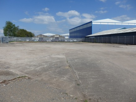 Prominently located secure compound site on junction of Kingstown Broadway and Parkhill Road. Surfaced in a mixture of concrete, tarmac and compacted hardcore. All services available on site. New 5 year lease or longer. Terms: Rent: £25,000 pa....