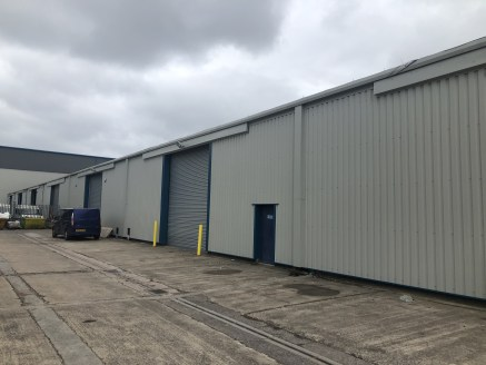 A terraced industrial / warehouse unit   7,060 sq ft  Rent £3.50 p.s.f