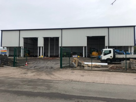A new development of three industrial/warehouse units of portal framed construction with a minimum eaves height of 203 (6m) rising to an apex of 279.
