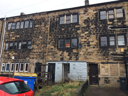 The premises briefly comprise a stone built mid terrace retail unit located on the busy Halifax Road running through the centre of Todmorden Town.  The property is set out over 3 floors having a retail area to the ground floor and ancillary storage t...