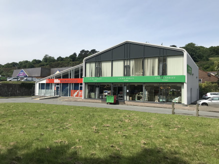 Retail units totalling 5,875 sq ft available FOR SALE or TO LET fronting Caernarfon Road, Bangor, adjacent to proposed Aldi, with planning permission to split and A3 use.  The property is arranged on ground and first floors.  Planning permission has...