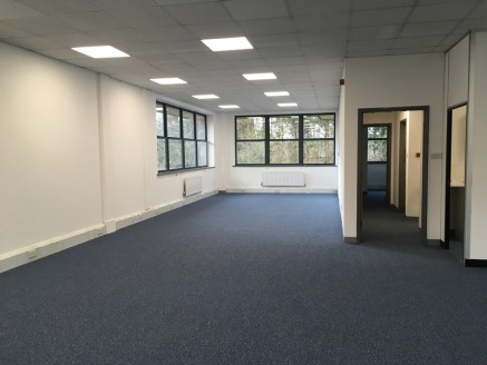 The property comprises a modern first floor office suite with tiled carpet flooring, suspended ceiling, perimeter trunking, central heating and double glazing. The office is predominantly open plan incorporating a partitioned director's office and me...