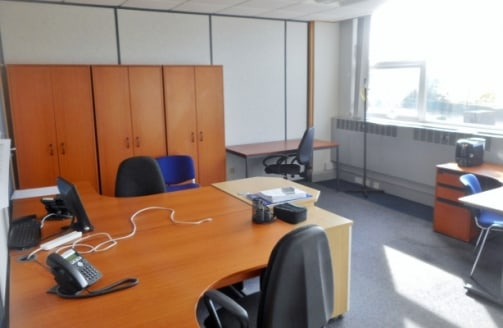 The property comprises serviced office accommodation within a modern two-storey office building operated by APT Solutions Limited. It benefits from extensive on site car parking and secure perimeter fencing....
