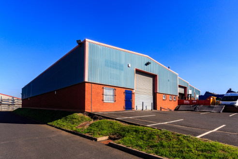 The unit is an end single terrace bay industrial unit of steel portal frame construction with brick infill and part brick an profile metal sheet cladding, with a pitched lined roof incorporating translucent lights. The unit benefits from forecourt ca...