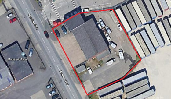 The subject property is a vehicle workshop unit comprising a pitched cememnt sheet roof, brick elevations and a concrete floor with two pits. The unit provides four work bays, each with a steel roller shutter door. The unit also has a small office, k...
