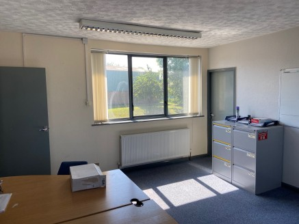 The property comprises a detached single storey warehouse unit over two bays with a cement sheet roof that incorporates translucent roof light panels, brick/block walls and a concrete floor. This is fronted by a brick built two storey office block wi...