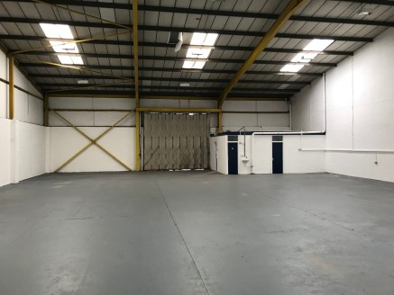 Unit 6 is an end of terrace industrial unit, the premises is a mainly open plan warehouse with the benefit of two internal offices and separate kitchen.  Access is via a manual concertina door and the estate is fully fenced with lockable secure gates...
