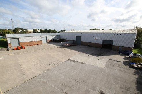 The property comprises a two unit industrial/hybrid scheme with the following high level specification.  - Highly prominent site fronting Gelderd Road  - Well maintained fully fenced site with secure entry intercom entry system  - Open span warehouse...