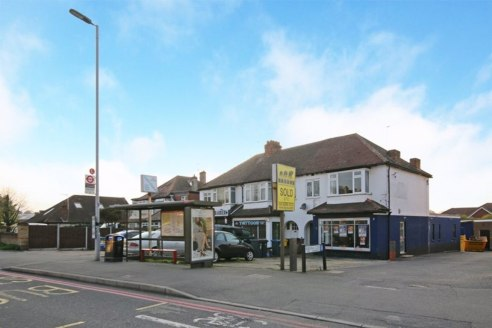 Freehold Investment / development opportunity comprising ground floor commercial unit with studio flat and modern detached outbuilding to the rear with additional land and detached lock up garage. Please note the first floor flat is sold off on a lon...