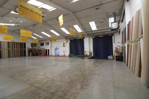 LARGE industrial warehouse/trade counter premises with secure yard in SELLY...
